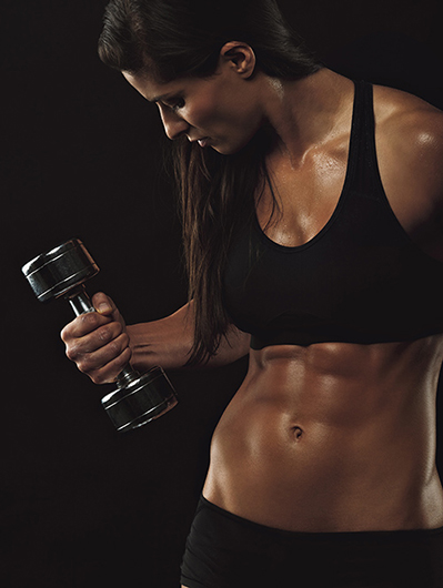 Female fitness model exercising